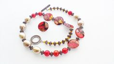 Hand Crafted Beaded Necklace & Ring . Multi Colored Floral Round Shell Beads. Orange Seed Beads.Taupe Oval Semi Precious Beads. A Great Gift