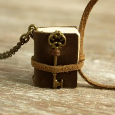 I need to get this for my little book worm!  Miniature Brown Leather Journal Necklace with Victorian Era-inspired Key Charm/Made-to-Order Book Necklace