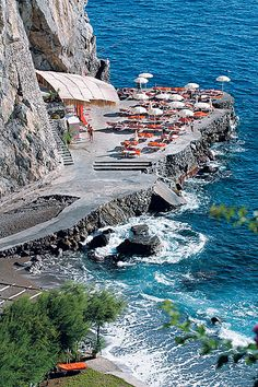 The beach of the San Pietro Hotel in Positano on the Amalfi coast, Italy, is a natural cove where an elevator, carved in the cliff, will take you from the hall to this heavenly spot. Great Places, Places To See, Beautiful Places, Dream Vacations, Vacation Spots, Voyage Europe, Amalfi Coast, Places Around The World, Italy Travel