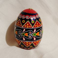 Pysanky.Rich colors on a goose egg.Ukrainian Easter Egg with hearts,triangles,waves,royal blue,red more.Traditional Pysanky. Made in USA