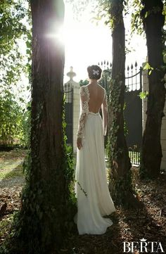 wedding dress inspiration...bare open back with long sleeves. maybe with long old hollywood style backdrop necklace