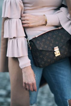 nude Statement Sleeves with classy Camel Coat and Louis Vuitton Pochette metis
