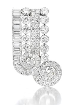 Rubel. A Platinum and Diamond Clip Brooch, Rubel Feres. Available Exclusively at FD. www.fd-inspired.com