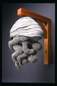 ">>>Adrian Arleo -Ceramic Sculpture..""is a sculptor living near Missoula, Montana whose ceramic works hybridize the human figure with animal and environmental imagery. Among her creations are bodies pock-marked with honeycomb formations, people birthed from wasp nests, and animals whose skin ripple with human eyes. """