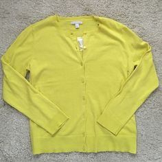 Cute cardigan New York & Company Never worn. Tag says XL but fits more like a large IMO. Making room in my closets. :) Smoke and pet free home. New York & Company Sweaters Cardigans