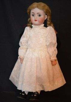 Here is a beautiful little girl that will fit right in with your other dolls. She is a Heinrich Handwerck Simon Halbig bisque head doll. She has a