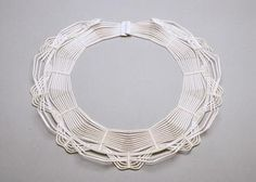 Lace Masai   Collar in silver and monofilament.   http://www.facerejewelryart.com/artist.php?id=3