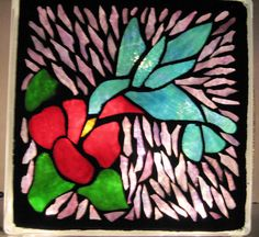 This is a glass block but the bird and flower shapes would make a lovely applique design and as they are made up of small pieces, they don't look too difficult.