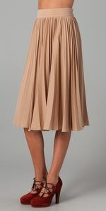 love the skirt. i wonder if i could pull off so much nude tone