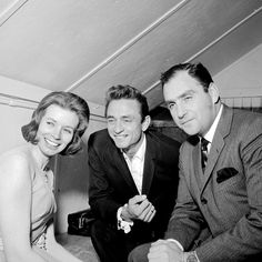 June Carter, Johnny Cash, and Saul Holiff, backstage in London, Ontario, 1964.