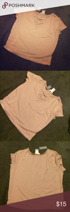 Crop tee Beautiful neutral color. Cris cross at top. Brand new and never worn Tops Crop Tops