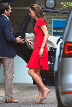 The Duchess of Cambridge in London on Thursday in a scarlet skater-style dress designed by LK Bennett and priced at £95