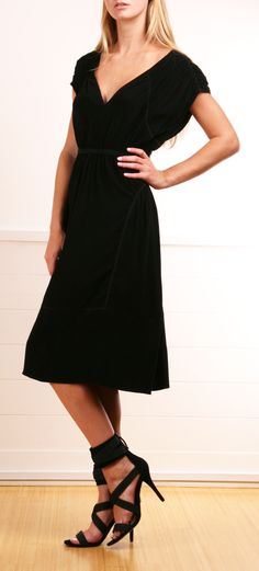Prada black dress.  Love the length and cap sleeves on this dress.  Wish I could wear shoes like this too!