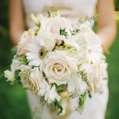 A wildly romantic bouquet in white and antique pink