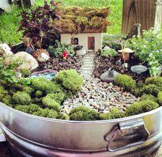 Fairy garden planted in a metal tub   fairiehollow.com