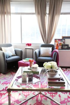 @nikki striefler Rappaport Home Tour // orange couch // studio apartment layout // grey chairs // @Rugs USA rug // coffee table styling // beige walls // colorful accents // photo by Sarah Winchester Studios