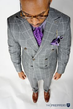 We like this clean double breasted windowpane suit ensemble.  BOLD colors!  Cut is very 2014.