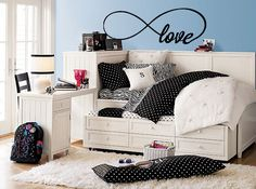 This design is a creative representation of how truly infinite love is. Shown here in our black #70 color with the 40 x 13 inch size.  Wall decals are precision cut adhesive vinyl words and designs that are applied to walls and other surfaces. Our decals are 100% removable, and look like they've been professionally painted once they?re ins...