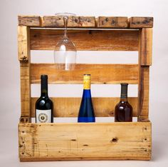 Reclaimed pallet wine rack with 4 wine glass slots. Hand rubbed oil finish maintains soft feel and rustic look of the wood. This piece has lots of personality and wood detail. Mounting instructions included. Imperfectly beautiful!