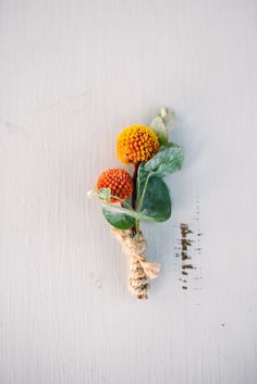 Orange and yellow craspedia boutonnieres - perfect for late summer or fall weddings