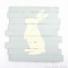 Create a simple and charming Easter Pallet Art using wood shims and glue.