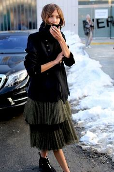 There's something so seasonally perfect about a pleated skirt. They could appear too back-to-school but luckily they've received an upgrade. This season they've gone from dressed up to dressed down, from feminine to tough (like pictured above) Alexa Chung's street style is consistently top notch. She looks absolutely stunning in a blazer, a tiered pleated metallic blend statement skirt and ankle boots.