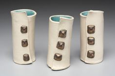 White Leather Cuff Bud Vase with Studs by MarnetteDoylePottery -,Similar style made as tea set for Lady Gaga by this artist.