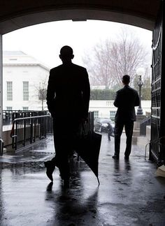 Cool picture...... President Obama waits for a heavy rain to pass before crossing West Executive Avenue from the Eisenhower Executive Office Building to the West Wing of the White House, March 12, 2013