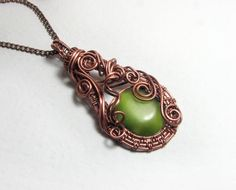 """A pendant made of copper with a green stone.Stone """"Cat's Eye"""". Handmade- Wire wrapped pendant- Copper jewelry- Wire wrapped jewelry- Boho by NatalkaArtCopper on Etsy"""