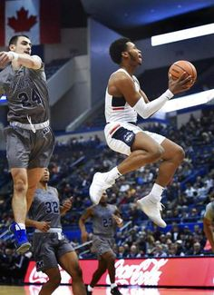 save off 2f0ed 88a41 Adams leads UConn over Monmouth 84-81 in overtime. Ncaa CollegeCollege  BasketballBasketball CourtUniversity ...