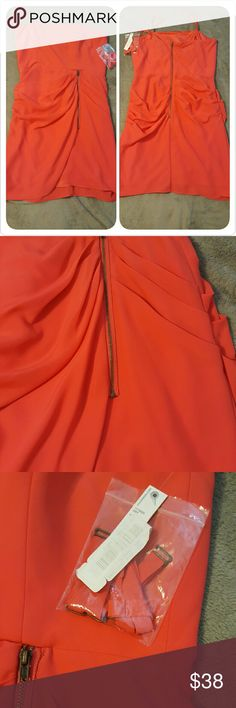 Coral strapless mini dress Beautiful coral dress with open zipper in the front and back of the dress. Comes with extra straps and tags. Fully lined Gianni Bini Dresses Mini