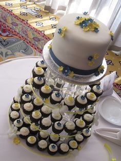Cupcake stand, with cake on top. Something similar to this. :)
