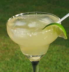 Mexican Beer Margarita: 1 bottle of Corona, 1 can 7-Up, 1 can frozen Limeade concentrate, 6 oz. Tequila, Lime wedges, Salt (optional)