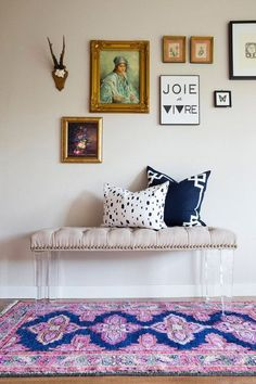 kismet rug in navy, bench, navy and white pillows, collected art