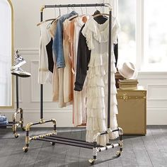 PBTeen Emily+Meritt Wardrobe Rack: Hang your favorite dresses, shirts, scarves and more from this rolling rack, inspired by a vintage find.