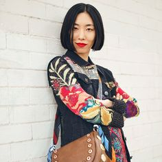 Urban magic with Lia Kim. Discover new black Exotic jacket with abundant embroidery with a touch of gold and colorful sleeves. Mix it with Desigual Exotic Jeans messenger bag; you can turn it into a belt! #BeExotic with Desigual Women's Exotic Jeans collection!