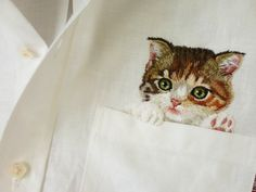 Shirts With Embroidered Internet Cats Peeking Out of the Pockets