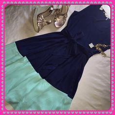 Girly Color Block Dress- HOST PICK! This Navy and Aqua Color Block Dress has a flowly fit-and-flare style which is very beautiful and classy. It's great for every shape but especially great for those those who have an hour-glass. The material has a very slight sheen to it. Dresses