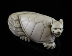 A Japanese ivory netsuke of a minogame, 19th century, 2.3in.