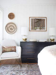 california eclectic master bedroom, Four Hands Suki dresser, Article Forma brass and white accent chair, vertical wall shiplap paneling from Metrie