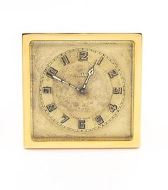Extra fine and one -of-a-kind Omega table clock with 8 day movement in pure art deco design of the 1920's. Guilded case, original dial with nice patina, beautifully engraved. Interestingly hinge engraved with a dove with palm tree, probably a sign of peace  after the first world war. Beautifully impressing. Collector's item. Find more details at our website, watch-time ID 513. #omega #omegawatches #clock #20 #artdeco