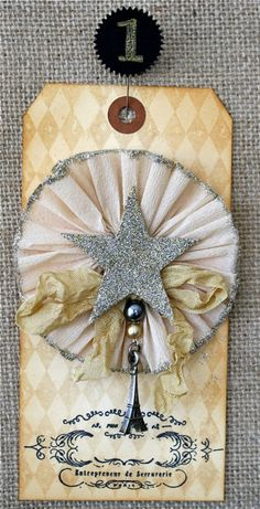 No. 1. Star Pinwheel. These aged tags are part of the Junk Drawer Advent Calendar series. Each has a tutorial.