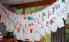 Great idea - Have guest decorate prepurchased onsies at the shower in all sizes and sleeve lengths!