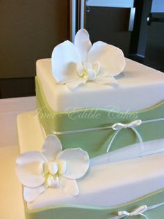 2 tier square wedding cake | two tier wedding cake with orchids 2