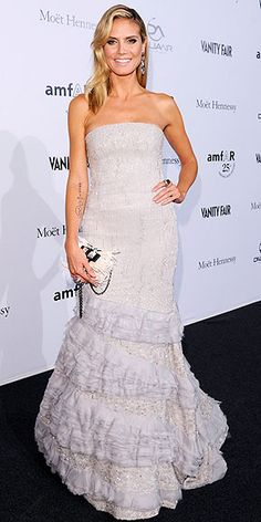 Heidi Klum.  Oh to look like her would be grand and I love this dress!!!