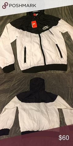 Nike Windbreaker Black and white Nike Windbreaker. New with tags. Was bought internationally, so tags say it's a 2XL, but fits like a US large. Nike Jackets & Coats