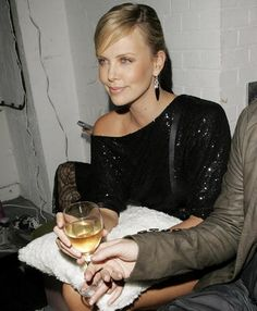 "Charlize Theron once said she'd ""rather get drunk on red wine and talk with people I love"" than go to fancy A-list parties. It appears a glass of white will do in a pinch."