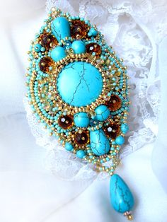 Bead embroidered Eastern style brooch with turquoise. $89.00, via Etsy.