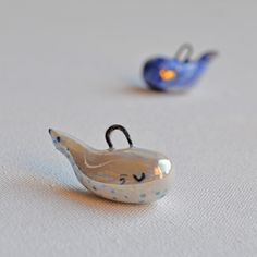 Pearl whale necklace  Hypnotizing whale covered with pearl luster  This item is 100% handmade high quality ceramics  #whale #whalenecklace #ilovewhales #waves #ceramicjewelry #ceramics #pendant #necklace #genuinegold #jewelry #artjewelry #clay #clayart #artwork #animallover #handpainted #handmadejewelry #handmadeceramics #bluewhale #fall #autumn #ceramicwhale #animaljewelry  #pendantofig #artjewelry #animalart #art #mrsbiscuit