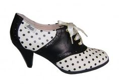 Bass Lady Oxfords  style #560531 lady oxfords - cream/blk dots    Dress to impress with these Lady heels from Bass! The black and creamy white oxford pumps are sure to make you look like a Lady with their chic style and flirty polka dot design. A fantastic modern twist on the classic look of the oxford!